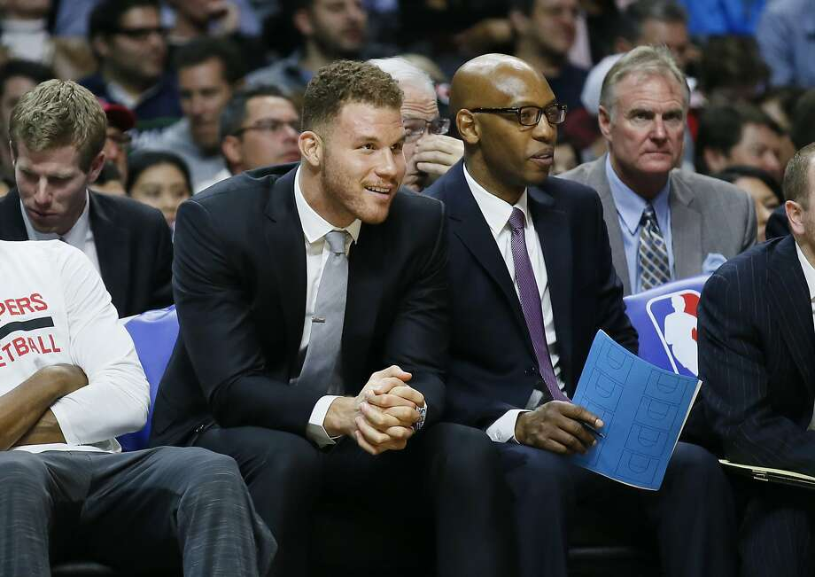 Blake Griffin (left, with Clippers assistant coach Sam Cassell in January) hasn't played since Christmas Day. Photo: Danny Moloshok, AP