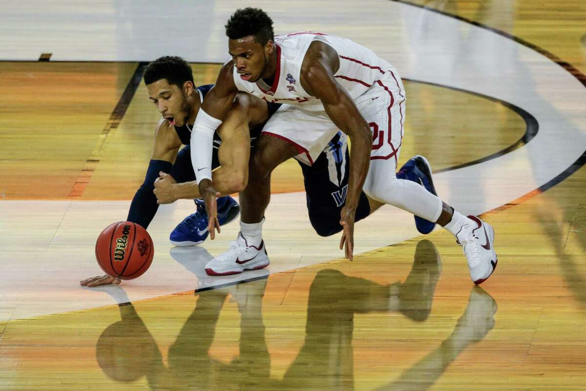 Villanova guard Josh Hart (3) and Oklahoma guard Buddy Hield (24) go to the floor for a ball in the NCAA Semi-Final game on Saturday, April 2, 2016, in Houston.