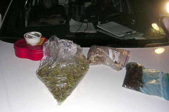 In this photo provided by the Louisiana State Police, various bags and items taken from the tour bus of Country music star Willie Nelson are shown after a traffic stop Monday, Sept. 18, 2006, in Lafayette, La. According to state police, Nelson and four others were issued misdemeanor citations for possession of narcotic mushrooms and marijuana after their tour bus was stopped Monday morning on a Louisiana highway. (AP Photo/Louisiana State Police via The Daily Advertiser) ** NO SALES **