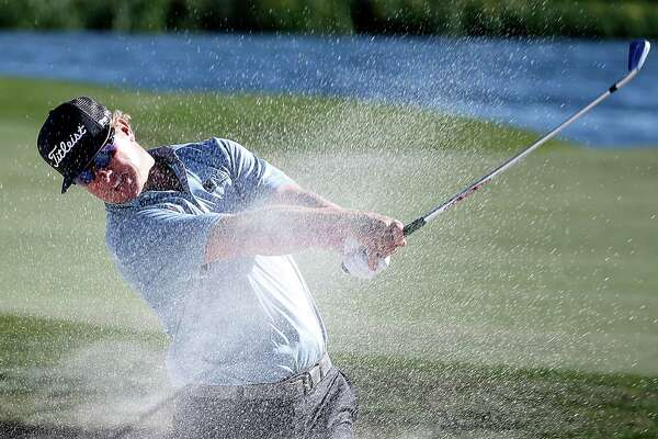 Charley Hoffman hits out of the bunker on hole 18 during the third  round of the Shell Houston Open golf tournament at the Golf Club of Houston on , Friday, April 2, 2016, in Humble, Texas.