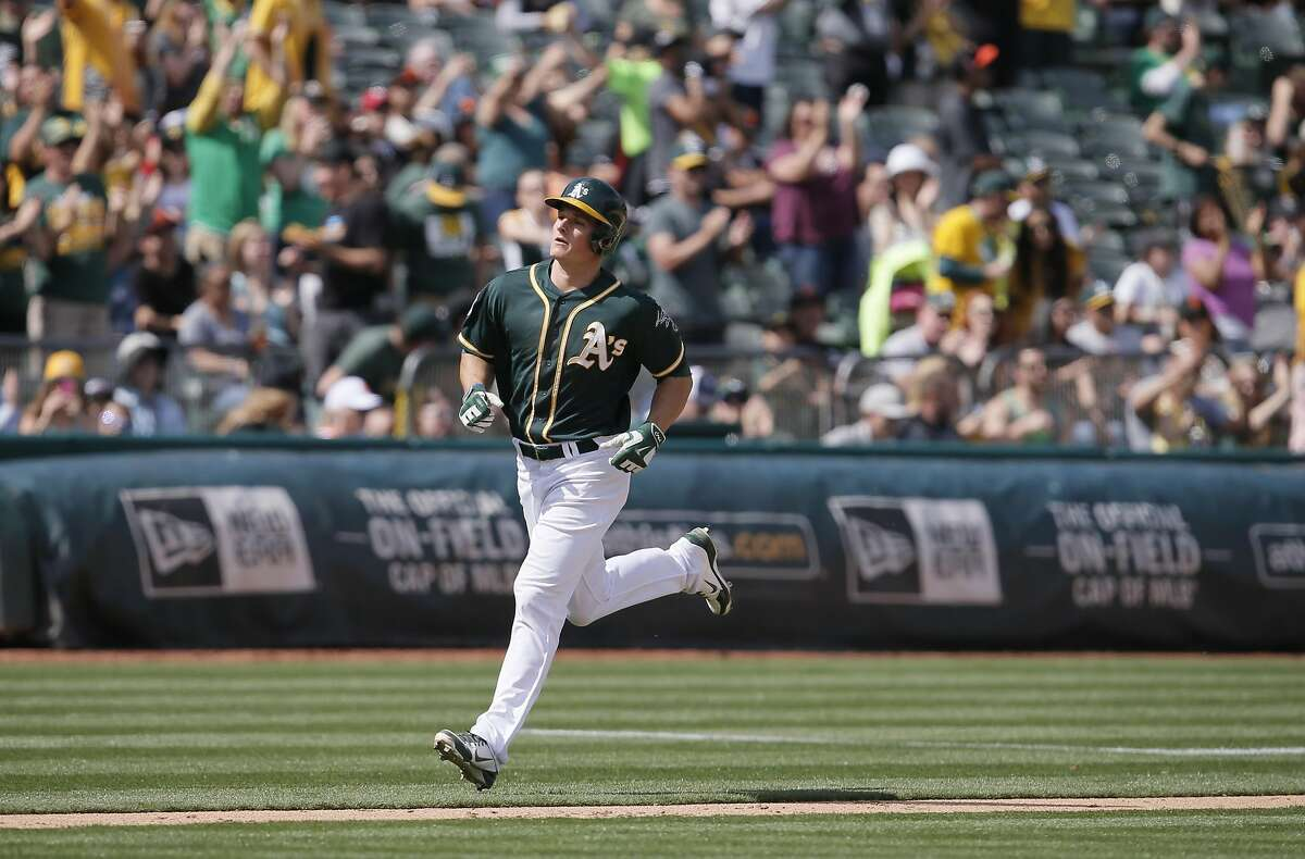 A's Matt Chapman, 36 heads for home after a solo home run in the 8th inning, as the Oakland Athletics went on to beat the San Francisco Giants 4-1 in the Bay Bridge series in Oakland, California, on Sat. April 2, 2016.