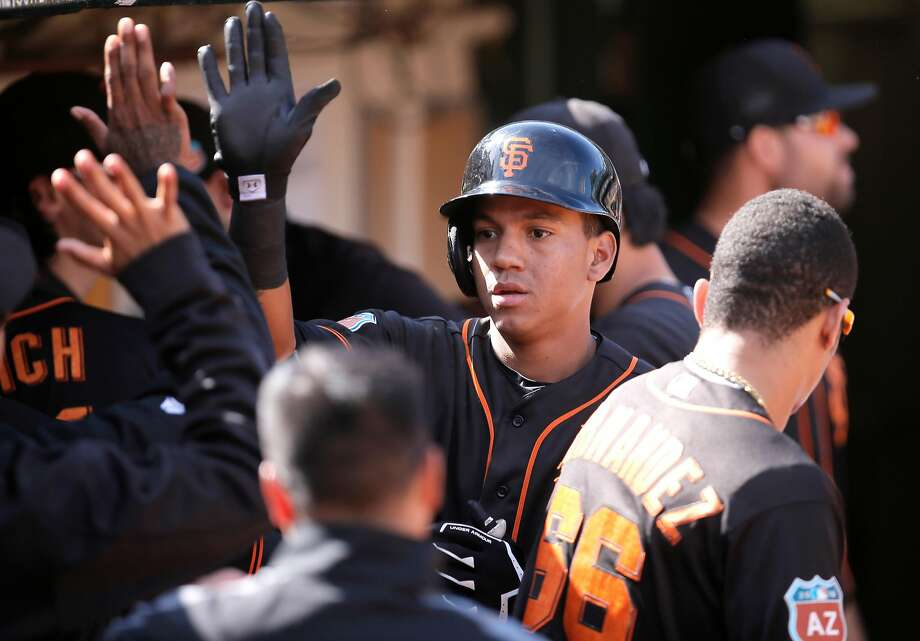 Giants' Ehire Adrianza, 13 put San Francisco on the board with a solo home run in the 9th inning, as the Oakland Athletics went on to beat the San Francisco Giants 4-1 in the Bay Bridge series in Oakland, California, on Sat. April 2, 2016 Photo: Michael Macor / The Chronicle