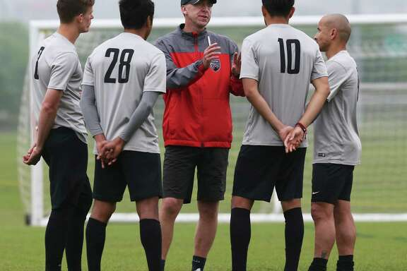 Coach Darren Powell talks with (from left) Michael Reed, Miguel Salazar, Carlos Alvarez and Rafa Castillo as he works out San Antonio FC at the STAR Complex on March 29, 2016.