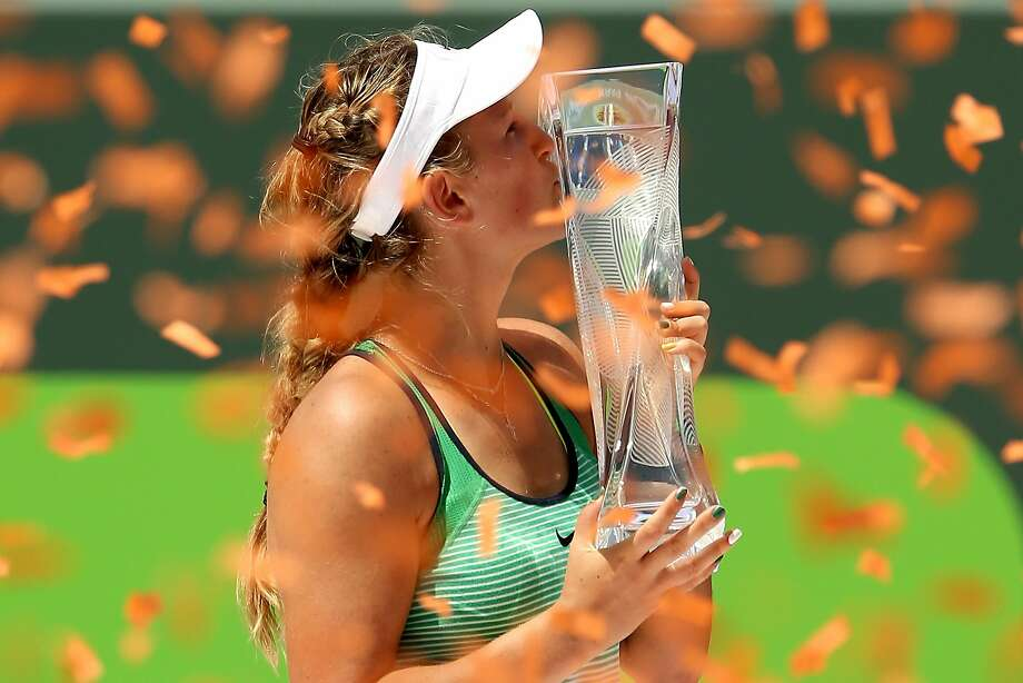 Victoria Azarenka kisses the trophy amid a hail of celebratory confetti after winning the Miami Open. Photo: Matthew Stockman, Getty Images