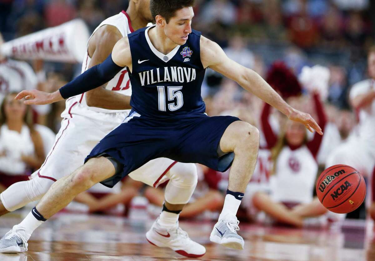 Villanova guard Ryan Arcidiacono (15) reaches for a loose ball during the NCAA Final Four semifinals at NRG Stadium, Saturday, April 2, 2016, in Houston.