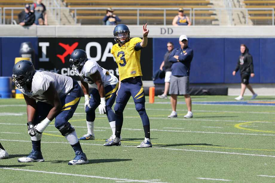 Cal quarterback Ross Bowers takes a signal at Saturday's scrimmage. Photo: Al Sermeno