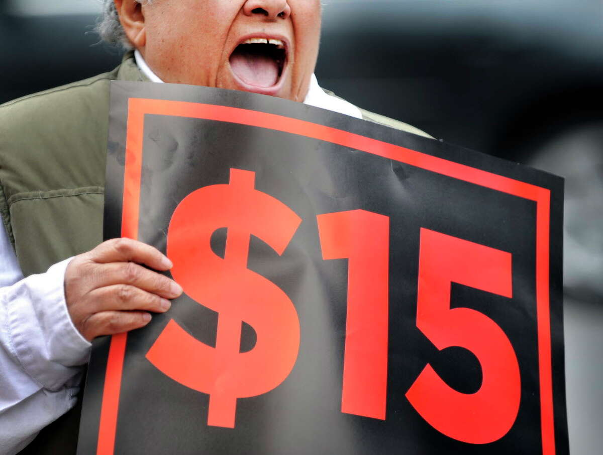 Ivette Alfonso, president of the state-wide board of Citizen Action of New York, yells out in support of the $15 minimum wage during a rally outside the offices of the Business Council of New York State on Thursday, March 24, 2016, in Albany, N.Y. The Business Council has come out against the $15 minimum wage. (Paul Buckowski / Times Union)