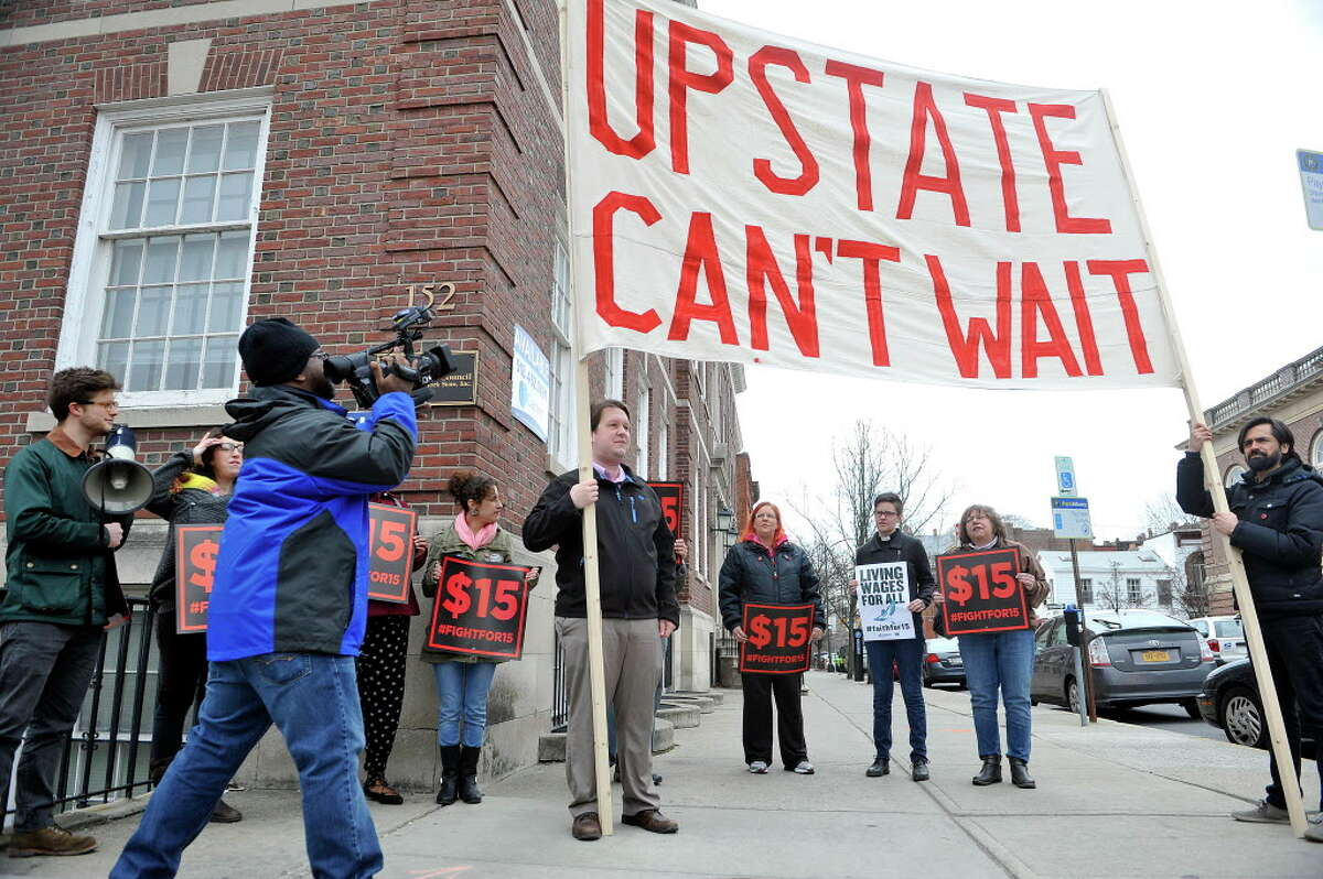 Supporters of the $15 minimum wage hold a rally outside the offices of the Business Council of New York State on Thursday, March 24, 2016, in Albany, N.Y. The Business Council has come out against the $15 minimum wage. (Paul Buckowski / Times Union)