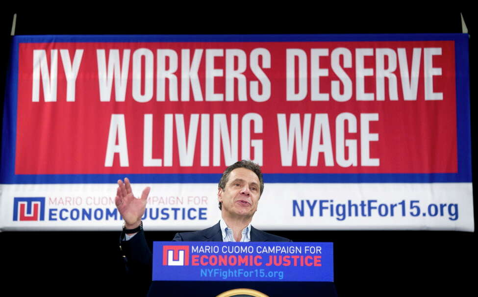 FILE--In this Feb. 25, 2016 file photo, New York Gov. Andrew Cuomo speaks during a rally to raise the minimum wage in Albany, N.Y. The biggest proposals of the year in Albany - a $15 minimum wage, paid family leave, higher taxes on millionaires, ethics reforms and a big jump in school spending _ will live or die this week as lawmakers piece together next year's state budget. (AP Photo/Mike Groll, File) ORG XMIT: NYMG305