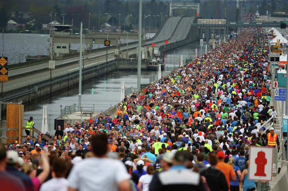 Thirteen thousand five hundred people participated in the Go Long 10-kilometer  fun run, sponsored by Virginia Mason Heart Institute, across the new State Route 520 floating bridge, Saturday, April 2, 2016, during a weekend grand-opening event in Seattle. The bridge will open to westbound traffic Monday, and to eastbound traffic later in the month.But before cars are gone forever from the deck of the old bridge (on the left in this photo), let's look back at the construction and use of the Evergreen Point Floating Bridge, er, Governor Albert D. Rosellini Evergreen Point Bridge, oh whatever, 520 bridge, over the many years it has served the Seattle region. Photo: GENNA MARTIN, SEATTLEPI.COM / SEATTLEPI.COM