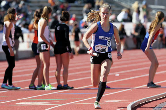 New Braunfels' Paige Hofstad takes off on the anchor leg of the high school girls 4x800 meter relay (section 2) during the Texas Relays at Mike A. Myers Stadium in Austin on Saturday, April 2, 2016. New Braunfels won the event with a time of 9 minutes, 45.37 seconds.
