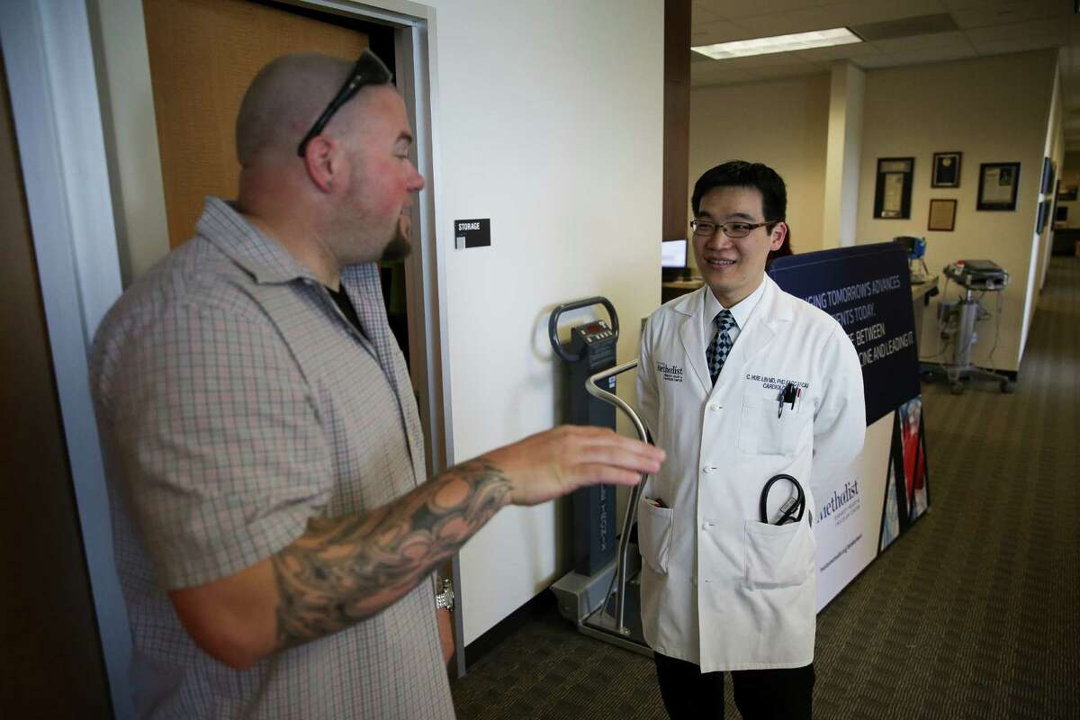 Clint Pharr, left, chats with Dr. C. Huie Lin, a congenital and interventional cardiology specialist, at Houston Methodist Hospital. Pharr had his first heart surgery when he was 15 months old to fix a congenital heart defect and a second when he was 33 to fix his pulmonary valve.