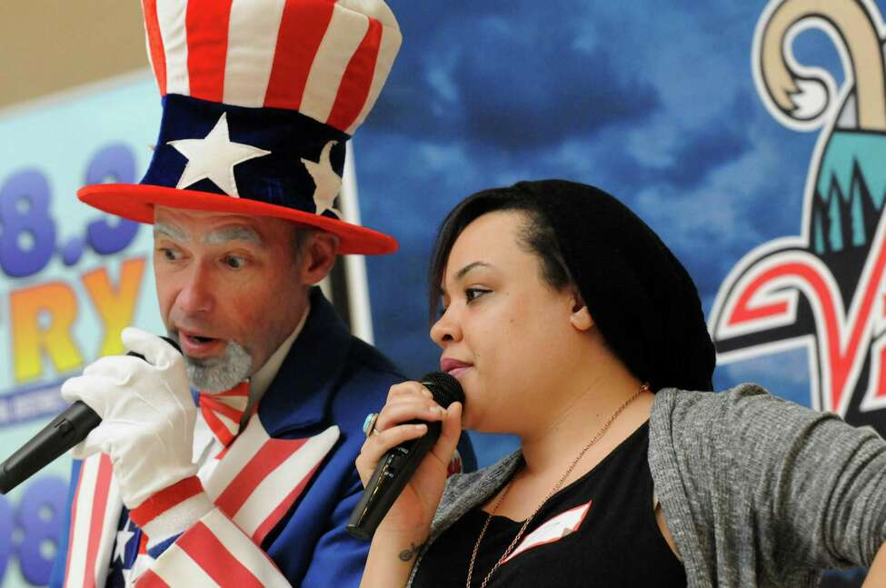 Brian Austn, aka Sammy, bantrrs with Jasmine Shea of Colonie before she performs her rendition during the Tri-City ValleyCats 6th Annual National Anthem tryouts at Crossgates Mall on Friday April 1, 2016 in Albany, N.Y. (Michael P. Farrell/Times Union)