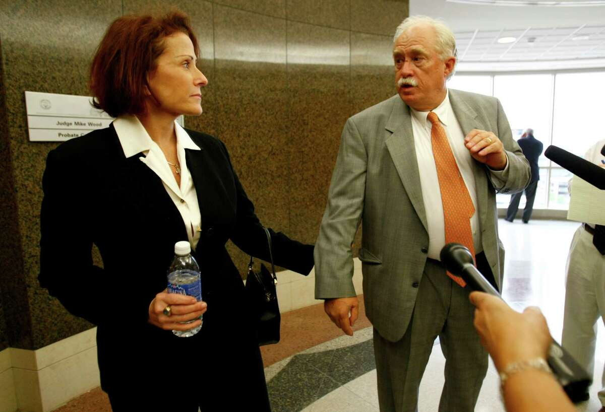 Darla Lexington, longtime female companion to John O'Quinn, speaks to the media with her attorney Jimmy Williamson, outside of Judge Mike Wood's courtroom, Friday,Aug. 6, 2010, in the Harris County Civil Courthouse, that five collectible cars that the administrator of O'Quinn's estate wants to sell at auction next week belong to her. John O'Quinn, was the wealthy lawyer who died in a car crash last year. The judge has decided to take the weekend to think about his verdict. ( Karen Warren / Houston Chronicle )