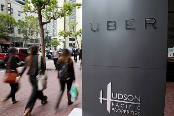 Foot traffic streams past Uber offices on Market Street in San Francisco, Calif.