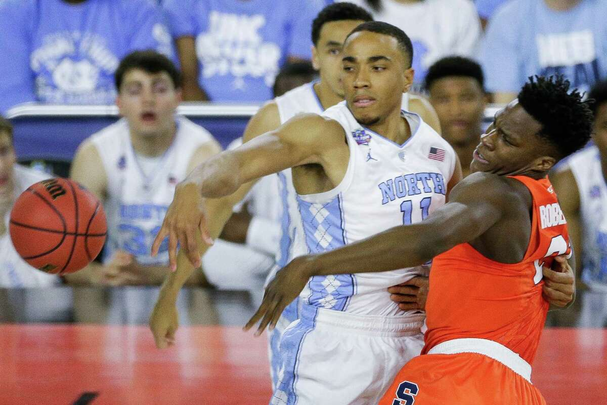 Syracuse forward Tyler Roberson (21) and North Carolina forward Brice Johnson (11) fight for the ball in their NCAA Semi-Final game on Saturday, April 2, 2016, in Houston.