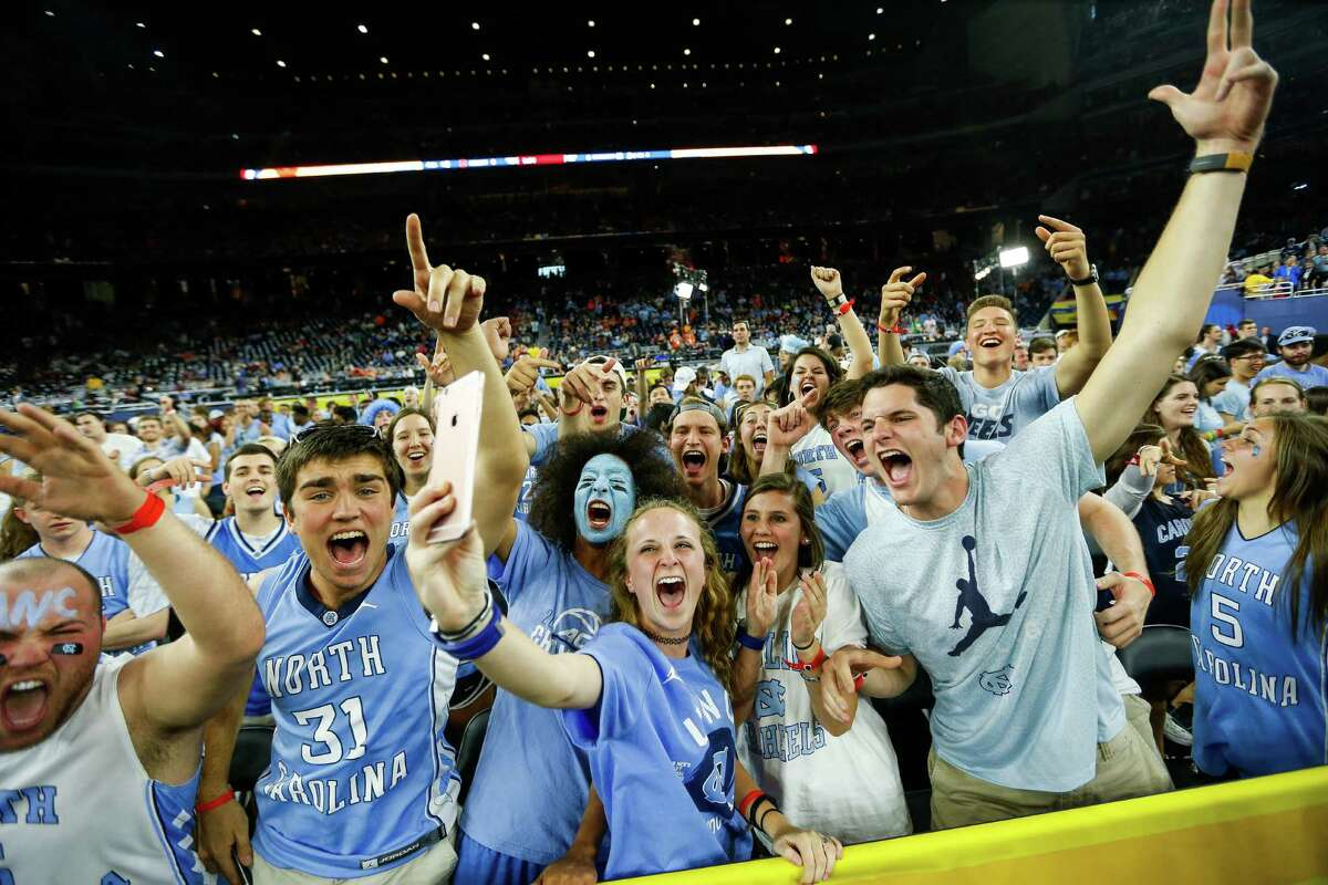 North Carolina fans cheer as they take a selfie during the NCAA Final Four semifinals at NRG Stadium, Saturday, April 2, 2016, in Houston.