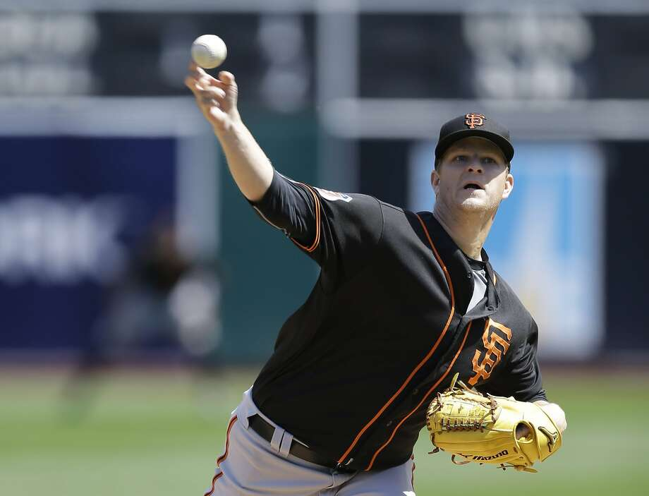 The Giants' Matt Cain pitches in the first inning against the A's. Photo: Ben Margot, AP