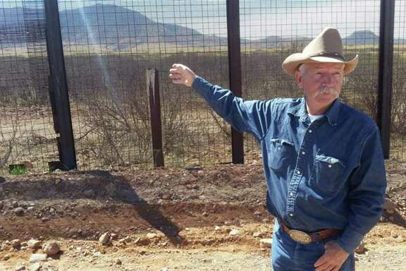 John Ladd stands along the road that separates his cattle ranch from the U.S.-Mexico border in Naco, Ariz. While the flow of illegal immigrants across the Southwest border has largely subsided, states are facing other security challenges.