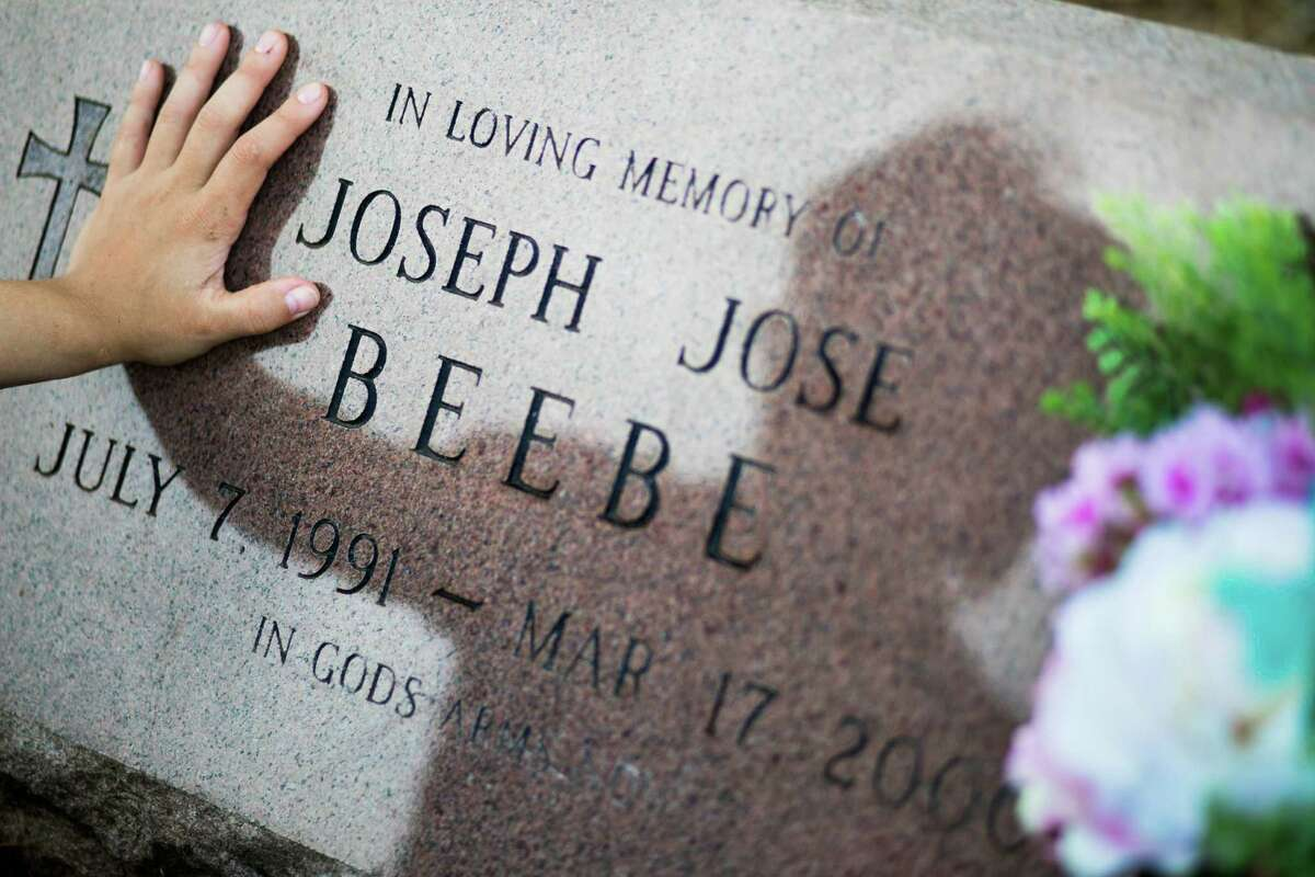 Amy Beebe, 24, looks for her brother's grave in Cleveland. Joseph Beebe was 8 when he died and like Amy and their sibling Jacob, as well as another child, had been abused by their adoptive mother in a home in Liberty County. Amy testifed during Edith Beebe's sentencing, before a judge gave the woman a 75-year term.