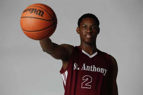 Charles Bassey of St. Anthony poses for the 2016 Express-News All-Area Super Team.