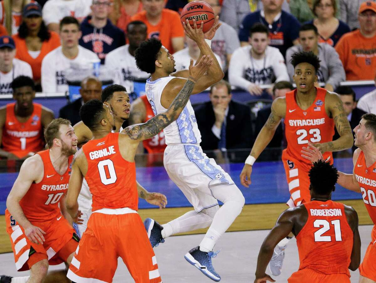 North Carolina guard Joel Berry II (2) goes up for a shot over Syracuse players in their NCAA Semi-Final game on Saturday, April 2, 2016, in Houston.