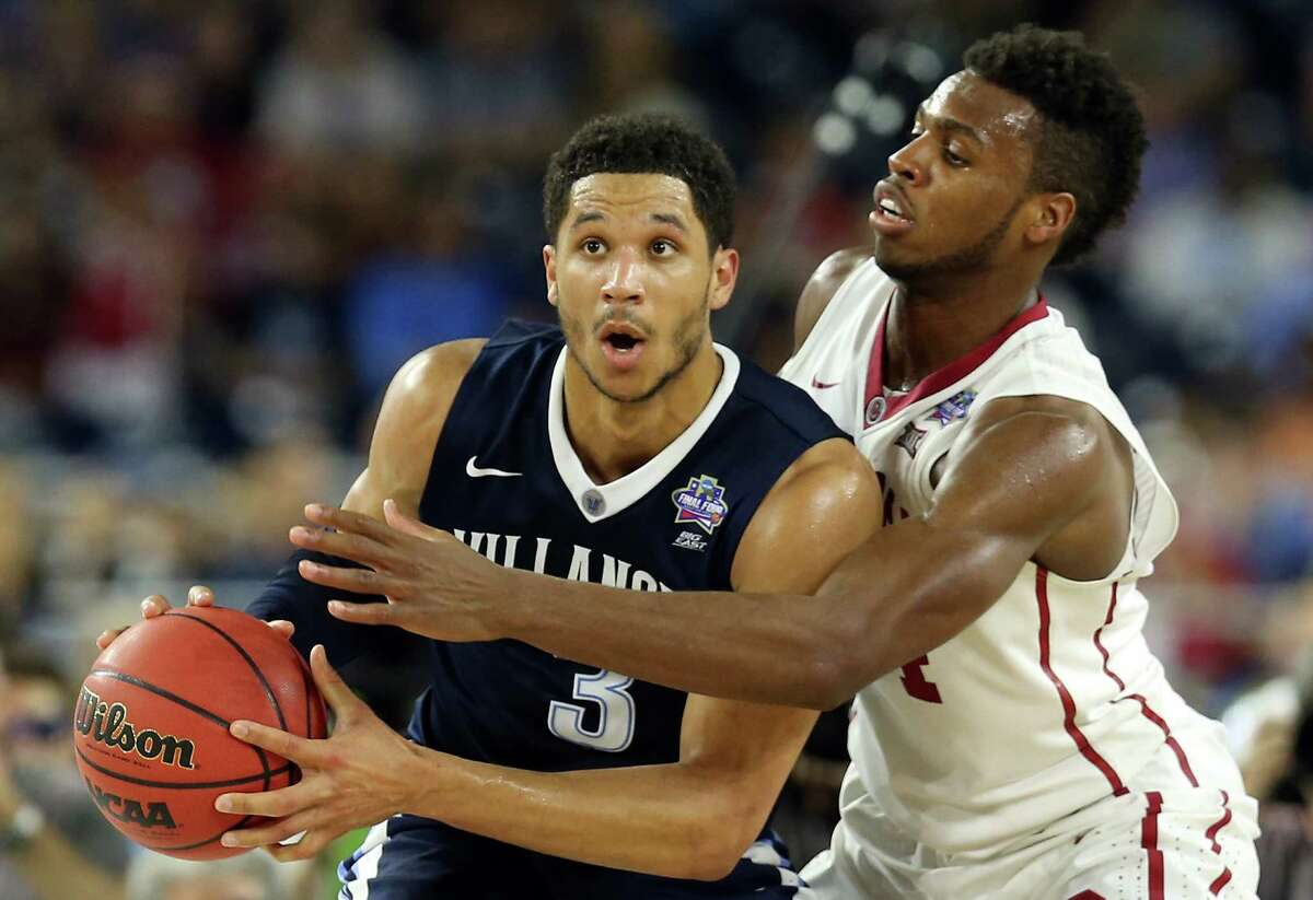 HOUSTON, TEXAS - APRIL 02: Josh Hart #3 of the Villanova Wildcats handles the ball against Buddy Hield #24 of the Oklahoma Sooners in the second half during the NCAA Men's Final Four Semifinal at NRG Stadium on April 2, 2016 in Houston, Texas.
