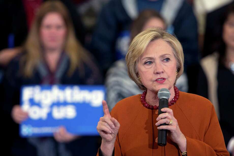 Hillary Clinton stressed her longtime record as a Democrat on Saturday at a Wisconsin rally, taking a swipe at rival Bernie Sanders, who had identified as an independent prior to the 2016 campaign. Photo: Mary Altaffer, STF / Copyright 2016 The Associated Press. All rights reserved. This material may not be published, broadcast, rewritten or redistribu