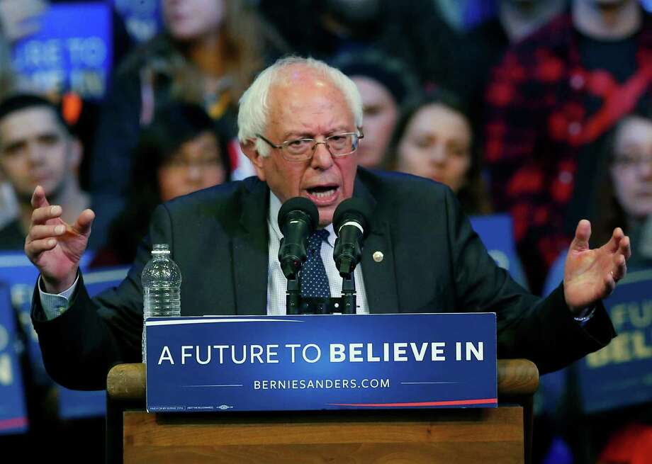 Democratic presidential candidate, Sen. Bernie Sanders, I-Vt,  addresses the crowd Saturday, April 2, 2016, a  a campaign rally at the University of Wisconsin-Eau Claire. (AP Photo/Jim Mone) Photo: Jim Mone, STF / AP