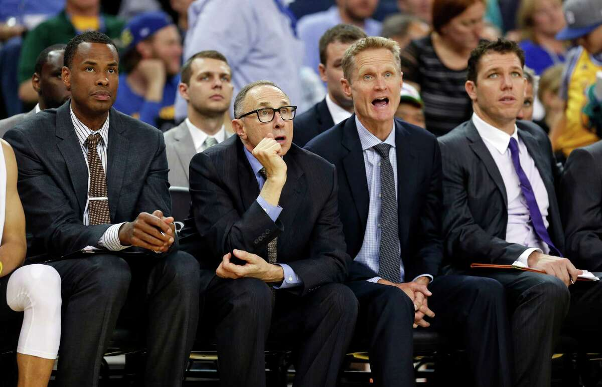 Golden State Warriors' coaches (from left) Jarron Collins, Ron Adams, Steve Kerr and Luke Walton watch from the bench during a 121-85 win over the New York Knicks at Oracle Arena in Oakland, Calif., on March 16, 2016.