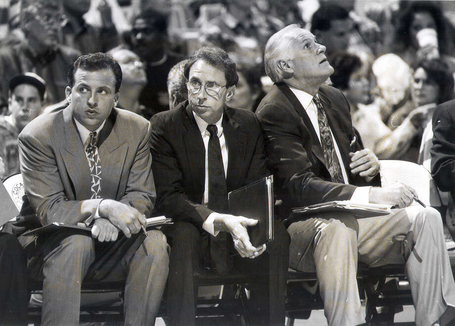 Spurs assistant coaches (from left) Tom Thibodeau, Ron Adams and Rex Hughes sit on the bench during a game in 1992. The trio served under head coach Jerry Tarkanian. Photo: Express-News File Photo