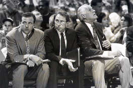 Spurs assistant coaches (from left) Tom Thibodeau, Ron Adams and Rex Hughes sit on the bench during a game in 1992. The trio served under head coach Jerry Tarkanian.