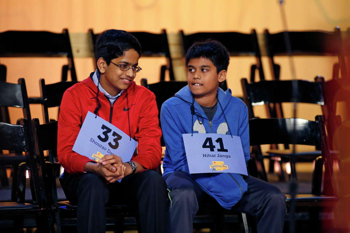 Shourav Dasari, left, and Nihar Janga encourage each other as they prepare to go to the final round to determine who will be the 2016 Houston Public Media Spelling champion.