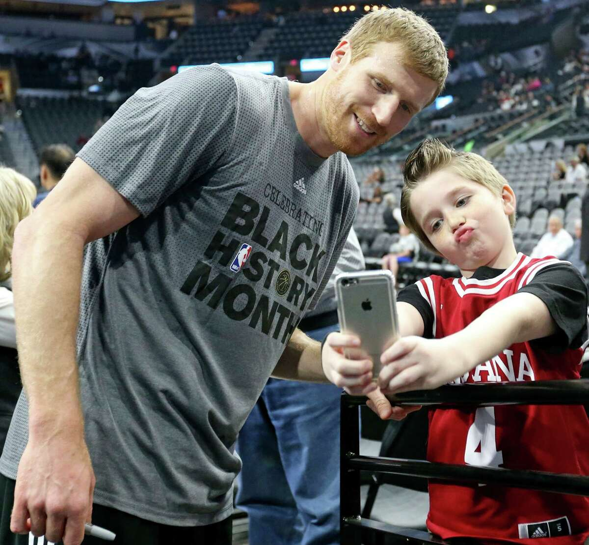 Spurs' Matt Bonner poses for a selfie with fan Cameron Collier before the game with the Orlando Magic on Feb. 1, 2016 at the AT&T Center.