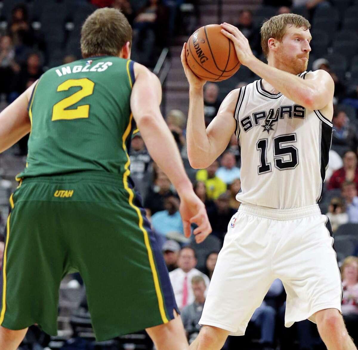 Spurs' Matt Bonner looks to pass around Utah Jazz's Joe Ingles during second half action on Dec. 14, 2015 at the AT&T Center.