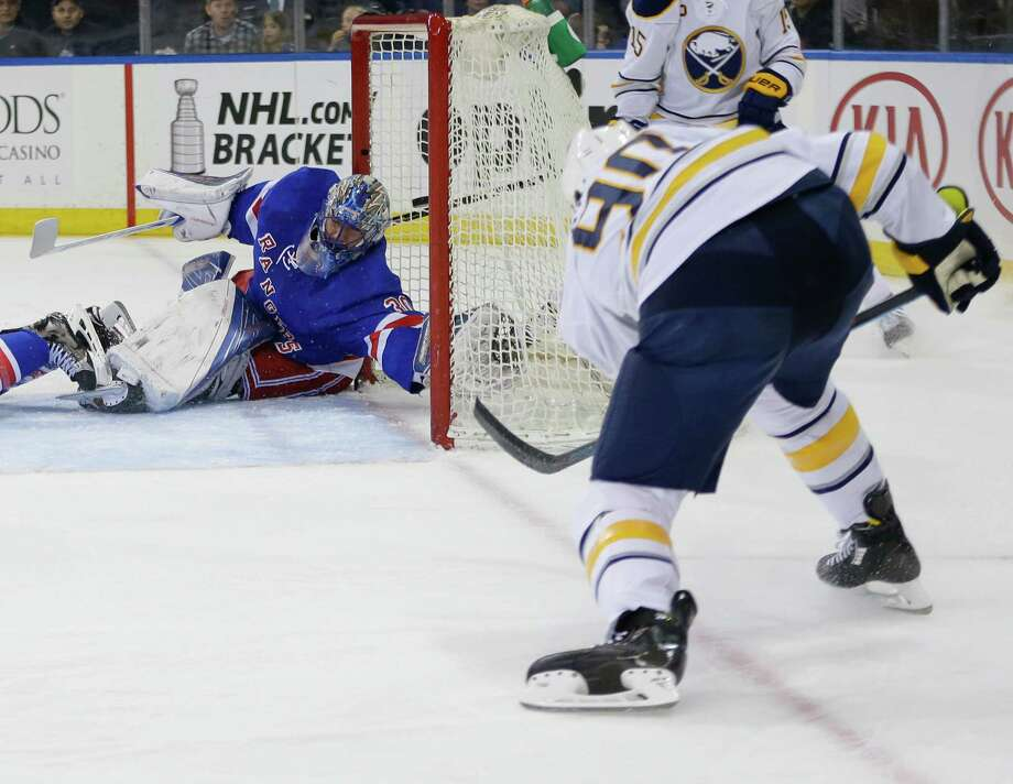 Buffalo Sabres' Ryan O'Reilly (90) shoots the puck past New York Rangers goalie Henrik Lundqvist (30), of Sweden, for a goal during the first period of an NHL hockey game Saturday, April 2, 2016, in New York. (AP Photo/Frank Franklin II) ORG XMIT: MSG102 Photo: Frank Franklin II / Copyright 2016 The Associated Press. All rights reserved. This m