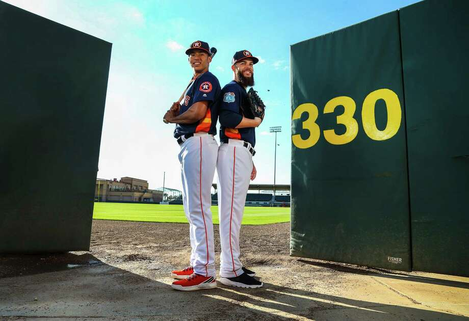 Playing 99 games in his first season, Carlos Correa, left, took AL Rookie of the Year honors, while Dallas Keuchel, who was 15-0 at home, won the Cy Young Award. Photo: Karen Warren, Staff / © 2015  Houston Chronicle