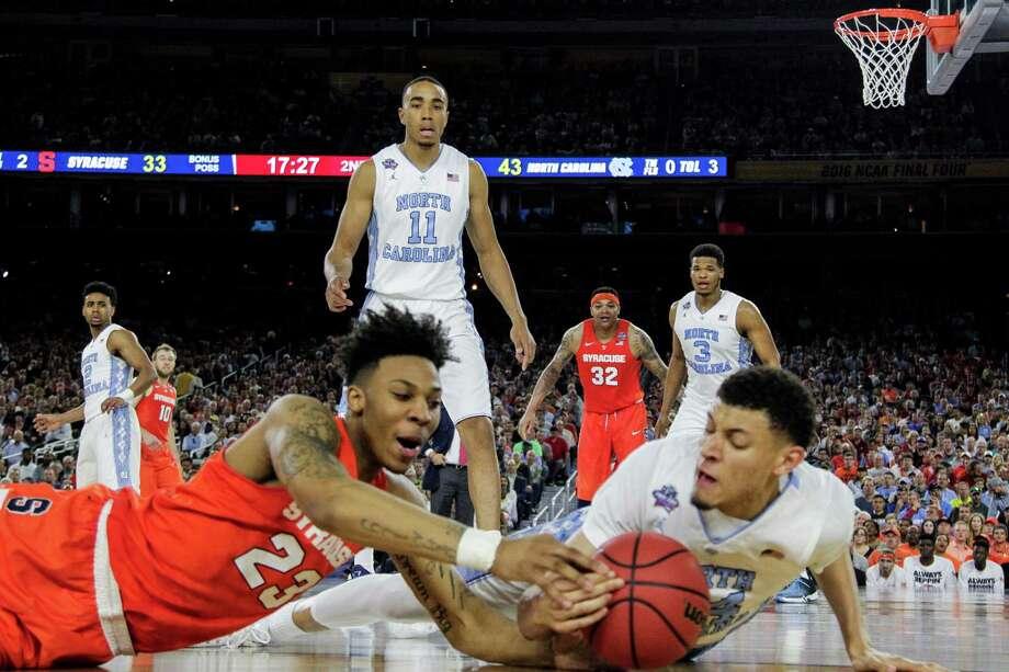 Syracuse guard Malachi Richardson, left, and North Carolina forward Justin Jackson hit the hardwood Saturday at NRG Stadium. Photo: Brett Coomer, Staff / © 2016 Houston Chronicle