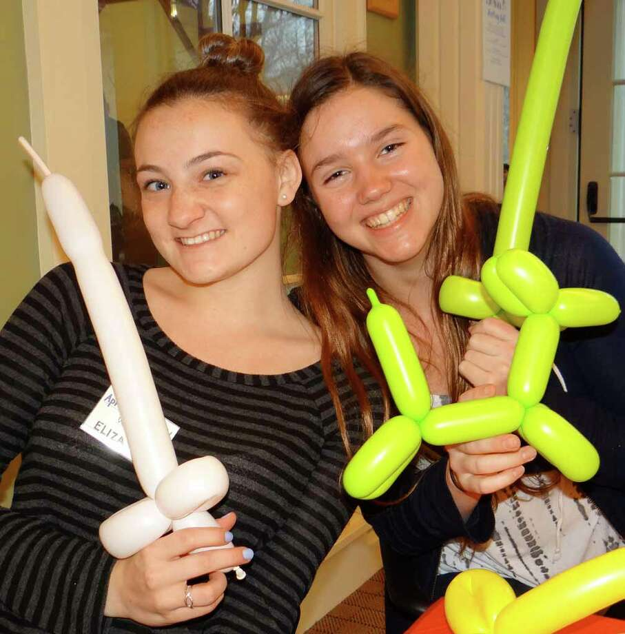 Eliza Donovan and Kacey Hertan fashioned balloon animals at Fairfield Museum and History Center's April Fools Night event. Photo: Fairfield Citizen / Mike Lauterborn / Fairfield Citizen