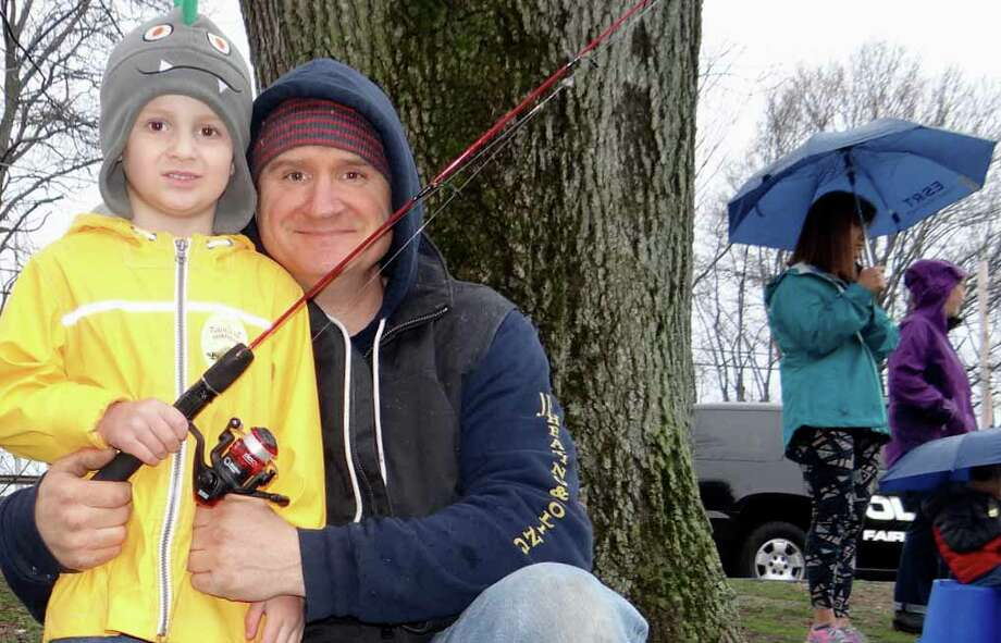 Joe Pozarlik, of Fairfield, with son J.J., 4, at Fairfield P.A.L.'s annual Trout Fishing Derby at Gould Manor Park. Photo: Fairfield Citizen / Mike Lauterborn / Fairfield Citizen