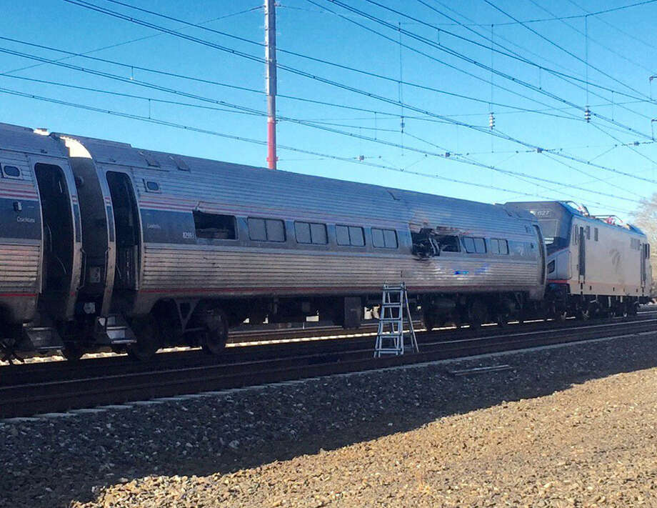 This photo shows an Amtrak train following an accident Sunday, April 3, 2016, in Chester, Pa. Amtrak said the train was heading from New York to Savannah, Ga., when it struck a backhoe outside of Philadelphia. (Glenn R. Hills Jr via AP) MANDATORY CREDIT ORG XMIT: NY115 / Glenn R. Hills Jr