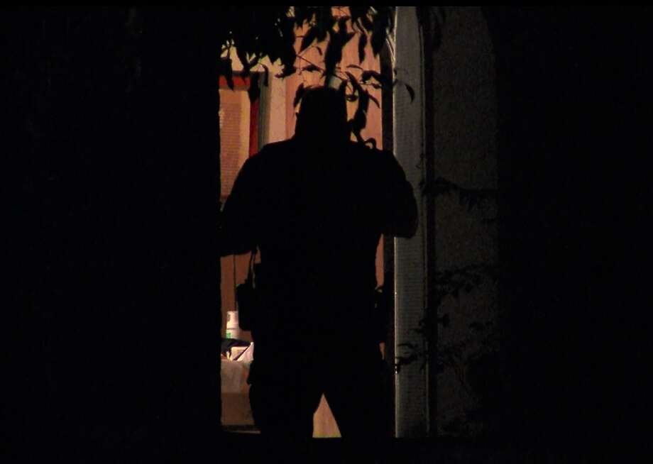 San Antonio police investigate a home invasion and assult on the Northwest Side Sunday, April 3, 2016. Photo: Screen Grab Courtesy 21 Pro Video