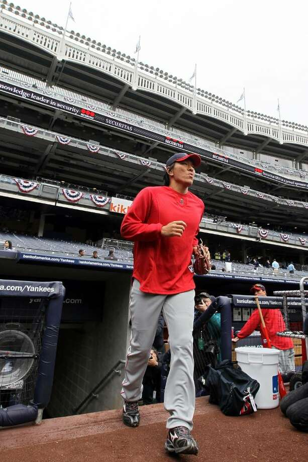 NEW YORK - APRIL 13:  Hideki Matsui #55 of the Los Angeles Angels of Anaheim takes the field for batting practice before playing against the New York Yankees during the Yankees home opener at Yankee Stadium on April 13, 2010 in the Bronx borough of New York City.  (Photo by Jim McIsaac/Getty Images) *** Local Caption *** Hideki Matsui Photo: Jim McIsaac, Getty Images / 2010 Getty Images