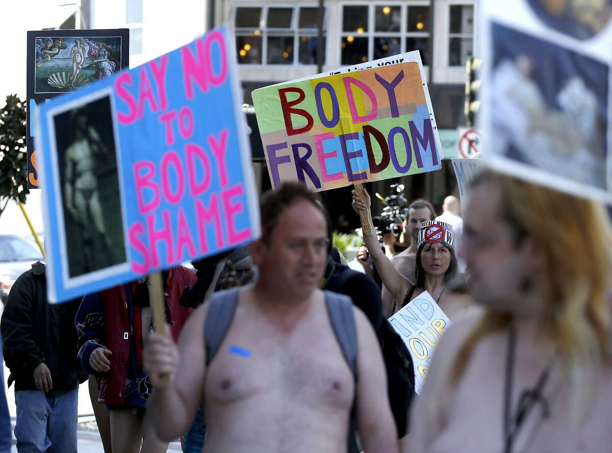People march down Market Street from Jane Warner Plaza during a nude parade to celebrate International Women's Day in San Francisco, California, on Sunday, April 3, 2016.