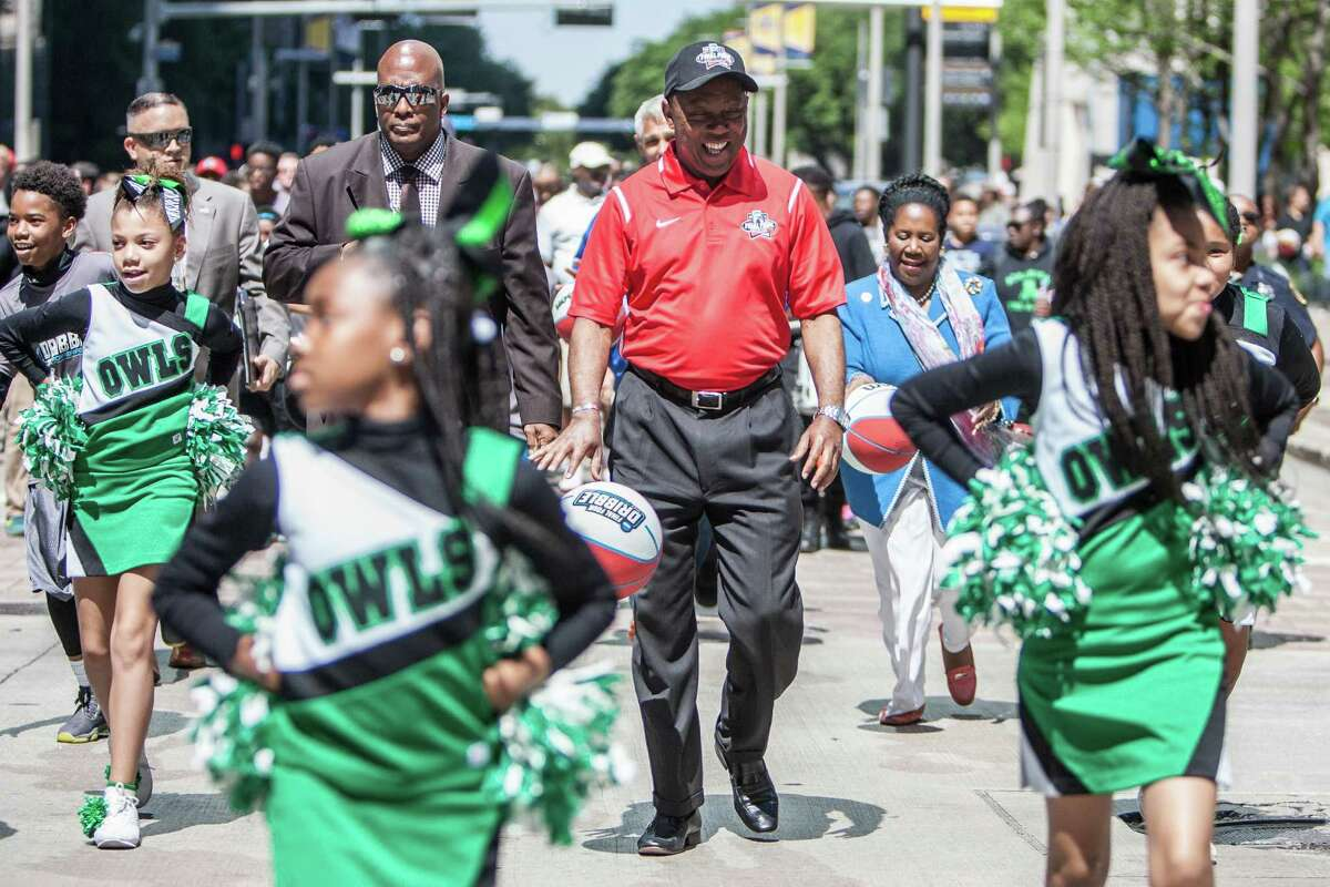 Mayor Sylvester Turner dribbles down the street during the NCAA Final Four Dribble event Sunday April 2, 2016. During the event children dribble basketballs from City Hall to the George R. Brown Convention Center where NCAA Final Four Fan Fest is being held.