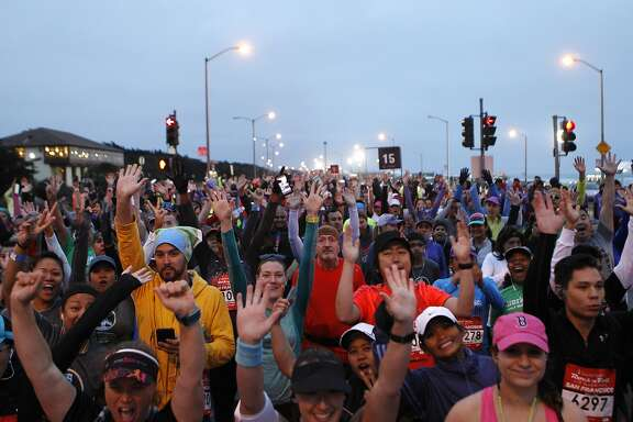 Hundreds of excited runners gather at the starting gate before the TransAmerica Rock 'n Roll Half Marathon in San Francisco, Calif., on Sunday April 3, 2016