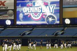 ST. PETERSBURG, FL - APRIL 3: The Tampa Bay Rays warm up before the start their Opening Day game against the Toronto Blue Jays on April 3, 2016 at Tropicana Field in St. Petersburg, Florida.  (Photo by Brian Blanco/Getty Images)