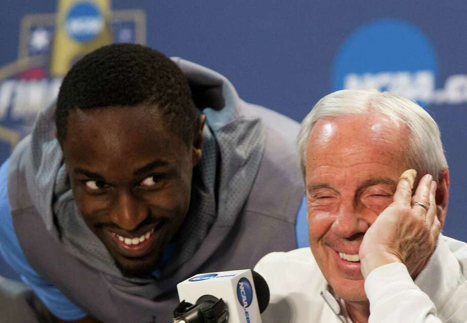 North Carolina forward Theo Pinson sneaks up behind head coach Roy Williams during a news conference before the NCAA basketball championship at NRG Stadium on Sunday, April 3, 2016, in Houston. Photo: Brett Coomer, Houston Chronicle / © 2016 Houston Chronicle