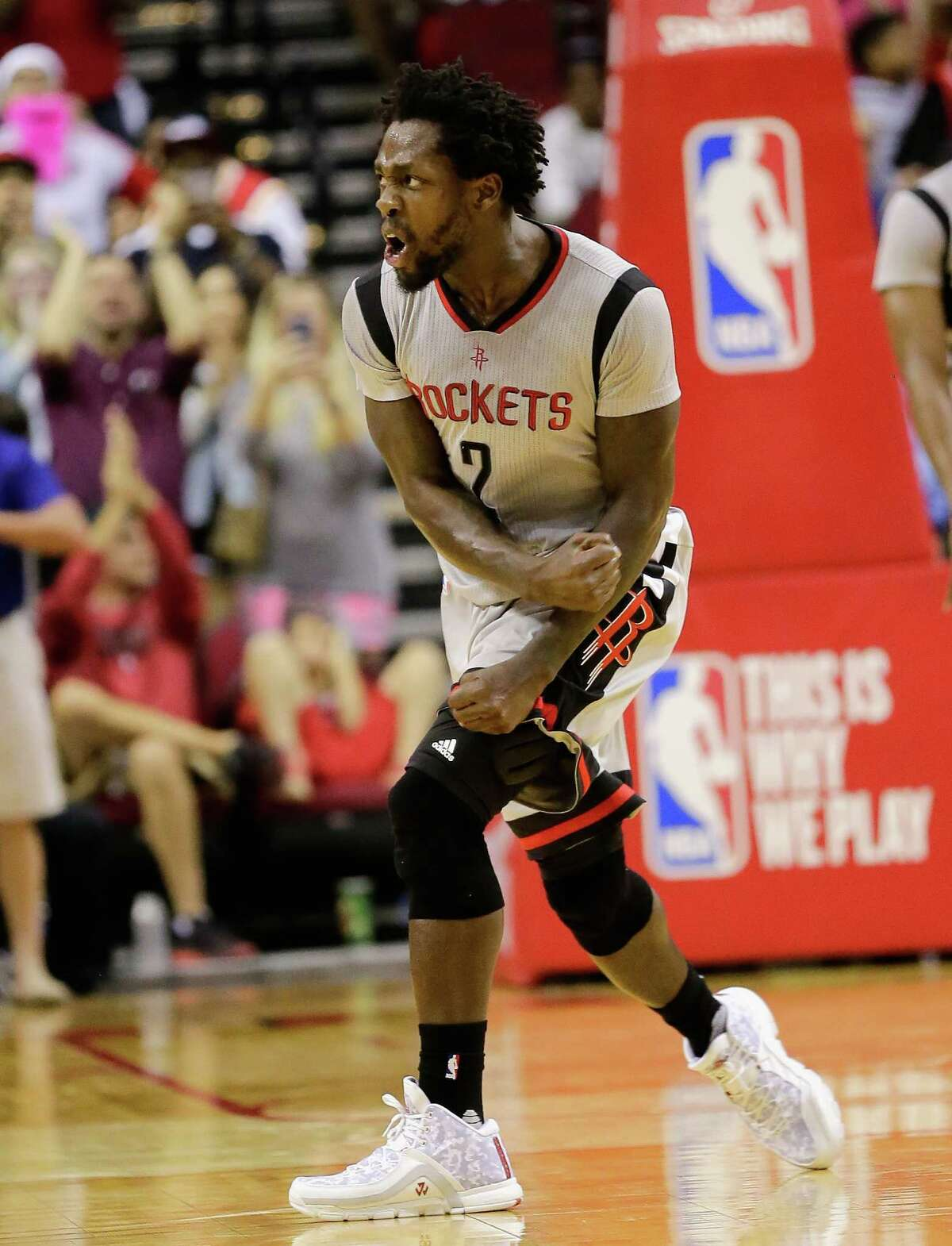 Houston Rockets' Patrick Beverley (2) reacts after making a basket towards the final seconds of the fourth quarter against the Oklahoma City Thunder's during a basketball game Sunday, April 3, 2016, in Houston. Houston won 118-110.