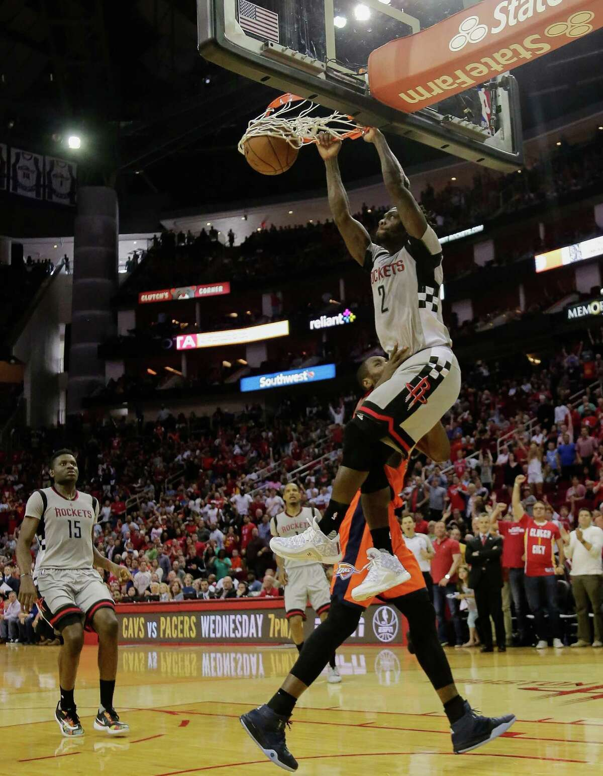 Houston Rockets' Patrick Beverley (2) dunks in the fourth quarter as Oklahoma City Thunder's Kevin Durant (35) walks by and forward Clint Capela (15) looks on during a basketball game Sunday, April 3, 2016, in Houston. Houston won 118-110.